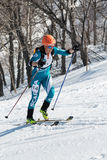 Ski mountaineering, Vertical race: woman ski mountaineer climb on skis on mountain. MOUNTAIN MOROZNAYA, ELIZOVO, KAMCHATKA, RUSSIA - APRIL 25, 2014: Vertical Royalty Free Stock Image
