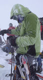 Ski mountaineering in winter during bad weather in the Swiss Alps Royalty Free Stock Photo
