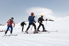 Ski mountaineers climb on skis on mountain. Team Race ski mountaineering. Russia, Kamchatka Stock Photo