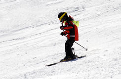 Ski in the mountains. Unidentifiable skier in the snow of the mountains royalty free stock images