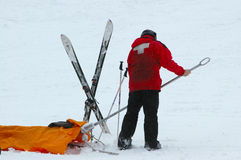 Ski Patrol. Skier getting some help from the ski patrol after breaking his leg stock photography