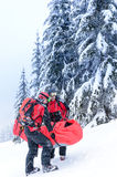Ski patrol carry injured person in stretcher. Ski patrol carry injured person skier in rescue stretcher snow Royalty Free Stock Photo