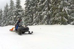 Ski patrol evacuate an injured skier Stock Photography