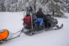Ski patrol evacuate an injured skier Stock Image