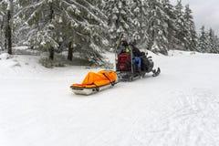 Ski patrol evacuate an injured skier Royalty Free Stock Images