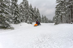 Ski patrol evacuate an injured skier Stock Images