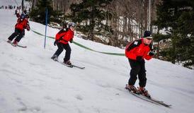 Ski Patrol Fireman's Hose Event. Spring Ski Celebration at Jiminy Peak Mountain in Hancock, Massachusetss includes Fireman's Hose Event. Ski Patrol detail Royalty Free Stock Photos