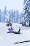 Ski patrol rescue injured skier after accident Royalty Free Stock Photo