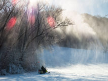 Ski patrol on snowmobile at Afton Alps ski field Stock Photos