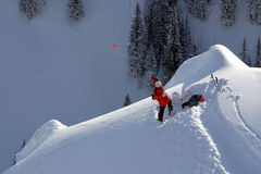 Ski patrol tossing hand charge stock photo