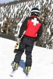 Ski-Patrouille mit Bohrgerät lizenzfreie stockbilder