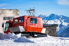 Ski piler. Mountain rangesSnowblower Snow plow for snowboarding and downhill skiing. The peaks of Elbrus. North Caucasus Russia. stock photos