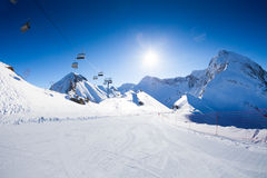 Ski piste panorama with ropeway chair lift Stock Photography