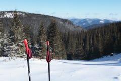 Ski poles against snow slope Stock Images