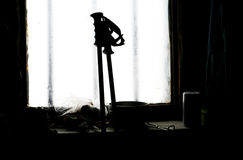 Ski poles against a window in the chalet. Ski poles against a window Royalty Free Stock Image