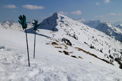 Ski poles with gloves and top of Rippetegg on background Royalty Free Stock Images