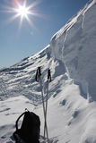 Ski poles and rucksack on snow. Ski poles and small rucksack sitting in the snow Royalty Free Stock Photography