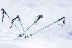 Ski poles in snow Stock Photos
