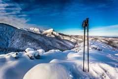 Ski poles at the top at sunrise in winter Stock Photos