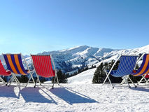After ski relaxation sunbeds in winter mountain scenery Royalty Free Stock Image
