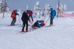 Ski rescue team with slide stretcher, brings help to ski during bad weather conditions.  royalty free stock image