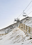 Ski Resort. Snowy landscape in a ski resort, with the cable cars climb to the summit Royalty Free Stock Image