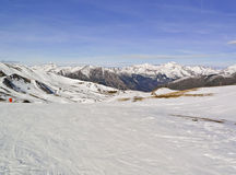 Ski Resort. Valley of a snow mountain area seen from the top of a ski resort Royalty Free Stock Image
