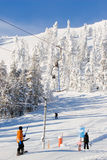 Ski resort. Skiers and snowboarders using ski lifts in nordic ski resort Stock Photography
