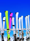 Ski resort. Skis on snow covered place in winter with mountains in the distance Stock Photography