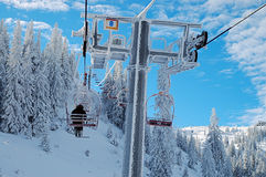 Ski resort. Skiers on a lift in a ski resort Royalty Free Stock Image