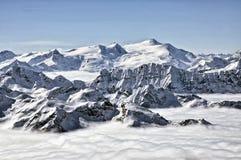 Ski resort in the Alps. Ski slopes, piste, powder snow in the mountains Stock Photography