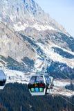 Ski resort in Austria. Cable car on the ski resort in Austria. On the background mountain and blue sky Stock Photos