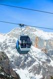 Ski resort in Austria. Cable car on the ski resort in Austria. On the background mountain and blue sky Royalty Free Stock Image