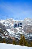 Ski resort in Austria. Cable car on the ski resort in Austria. On the background mountain and blue sky Stock Photography