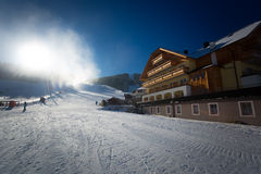 Ski resort at Austrian Alps with working snow cannons at sunny d Stock Images