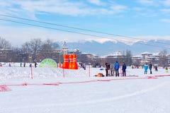 Ski resort Bansko, Bulgaria, people, mountains view Royalty Free Stock Photo