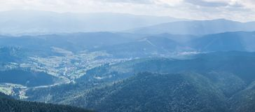 Ski resort Bukovel in Carpathians. Ski resort Bukovel in the valley of the Ukrainian Carpathians. View from the top of the Khomyak mountain on a sunny summer day royalty free stock images