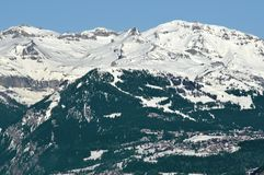 Ski resort of Crans Montana. The ski resort of Crans Montana in the lower part of the picture, with the ski area above in the swiss alps. Mont bonvin can be seen Royalty Free Stock Photo
