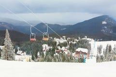 Ski resort Dragobrat, Ukraine. Ski lift. On the background of a beautiful winter mountain snowy landscape Royalty Free Stock Photo