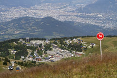 Ski resort and Grenoble city. Slopes over the ski resort of Chamrousse, and Grenoble city in the background during summer Royalty Free Stock Photography
