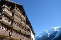 Ski resort hotel, France or Swiss Alps, copy space Stock Image