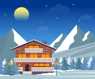 Ski resort, hotel or winter family house at night. Stock Photo