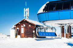 Ski resort image with chair lift and high station Stock Image