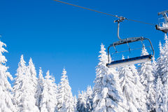 Ski resort image with chair lift and white snow pine trees Royalty Free Stock Images