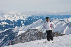 Ski resort of Kaprun, Woman and Kitzsteinhorn glacier. Austria Royalty Free Stock Images