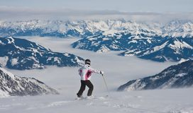 Ski resort of Kaprun, Woman and Kitzsteinhorn glacier. Austria Royalty Free Stock Photos