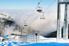 Ski resort Kopaonik, Serbia, ski lift, mountain view, fog Royalty Free Stock Images