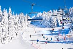Ski resort Kopaonik, Serbia, ski lift, slope, people skiing Stock Photos