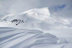 Ski resort landscape, waves of fresh snow and slopes tracks Stock Photo