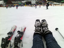 Ski resort. The legs in ski boots and skiing on snow Stock Images